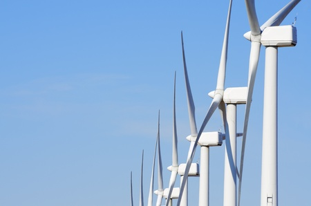 aligned group of windmills for renewable electric energy production, Cintruenigo, Navarre, Spain photo