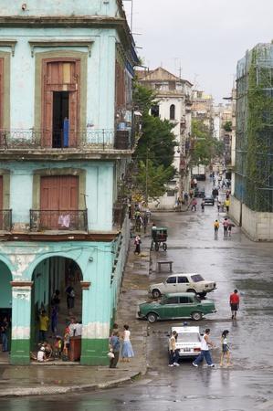 penury: Havana, Cuba - January 27, 2007: Cuban walking in a street in the old part of the city.