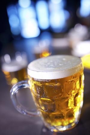 closeup of a beer mug in a bar photo