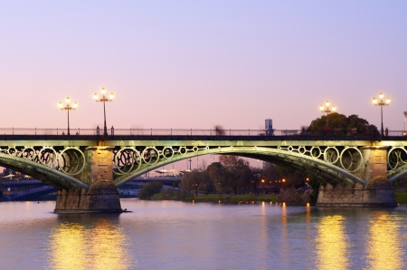 Triana bridge over the river Guadalquivir, Sevilla, Andalucia, Spain photo