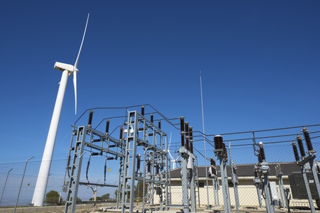 windmills for removable energy production and electrical substation photo