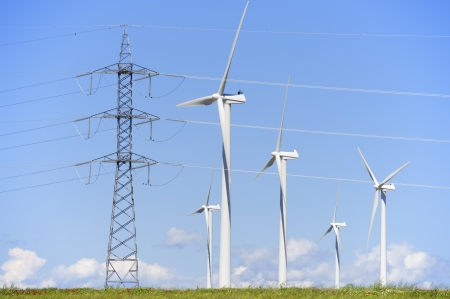 group of windmills for renewable electric energy production and pylon Stock fotó