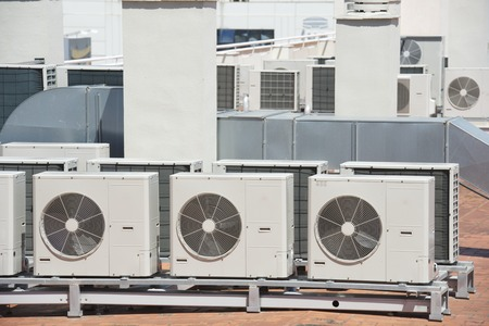view on the roof of a building of a large air conditioning equipment photo