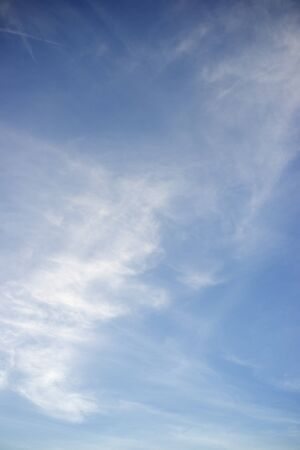 background created with blue sky and white clouds