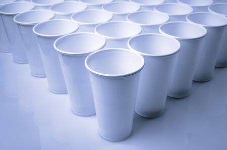 throwaway: large group of white disposable plastic cups Stock Photo