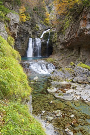 view of a waterfall in Ordesa Valley, Pyrenees, Huesca, Aragon, Spain photo