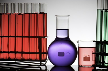 group of laboratory flasks with colored liquid photo