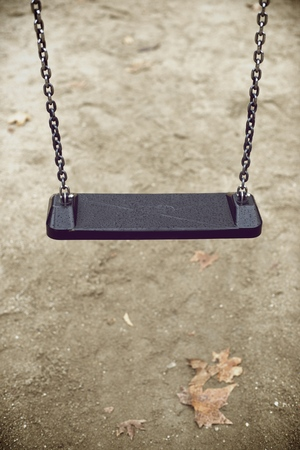 Closeup of a child swing with unfocused background photo