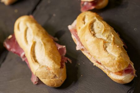 forefront: forefront of a group of Iberian ham sandwiches