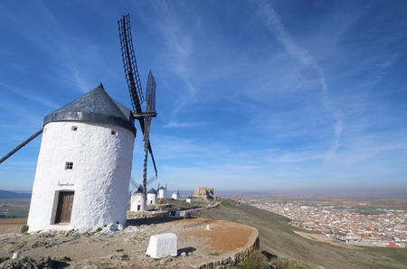 traditional windmills and castle in Consuegra, Toledo, Castilla La Mancha, Spain photo