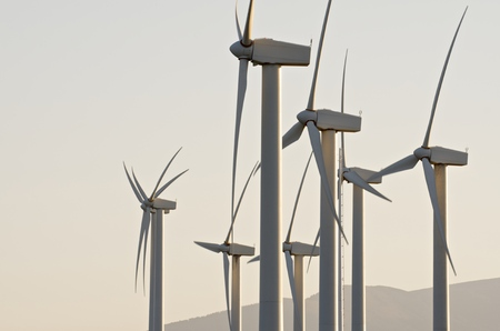 Windmills for renowable electric production with white sky, Zaragoza province, Aragon, Spain photo