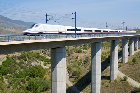 view of a high-speed train crossing a viaduct in Saragossa province, Aragon, Spain, AVE Madrid Barcelona. Stock Photo