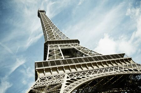 View of the Eiffel Tower with blue sky and white clouds, Paris, France photo