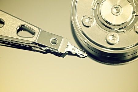 Closeup of an open computer hard drive photo