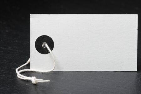 Blank label with twine on a black slate photo