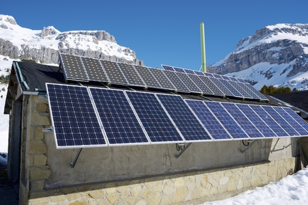 Photovoltaic panels on the roof of a hut in the Pyrenees, Aragues Valley, Aragon, Huesca, Spain. photo