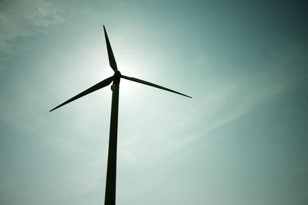Windmill for electric power production at sunset, Pozuelo de Aragon, Zaragoza, Aragon, Spain photo