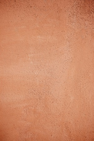 Ocher painted wall background in high resolution photo