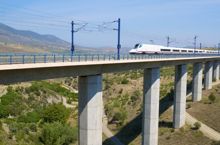 view of a high-speed train crossing a viaduct in Saragossa province, Aragon, Spain, AVE Madrid Barcelona. photo