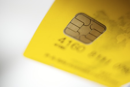 Detail of a credit card with a gold chip  photo