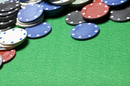 casino chips on a green felt photo