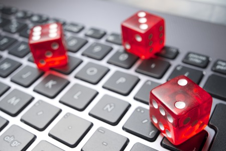 Dices group stacking on a laptop photo