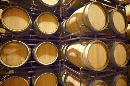 ferment: stacked wine barrels to ferment the wine, La Rioja, Spain