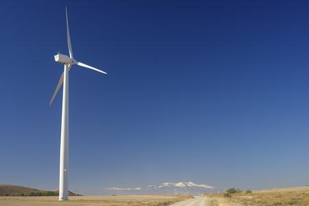 windturbine: Windmills for renewable electric energy production, at background is Moncayo Peak, Pozuelo de Aragon, Zaragoza, Aragon, Spain Stock Photo