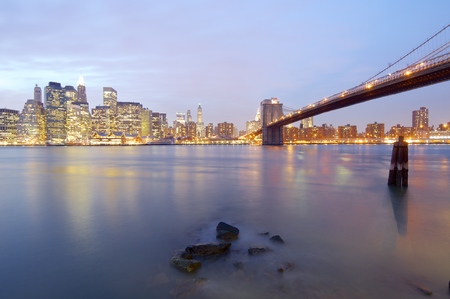 line of skyscrapers at dusk and Brooklyn Bridge, New York, Usa photo