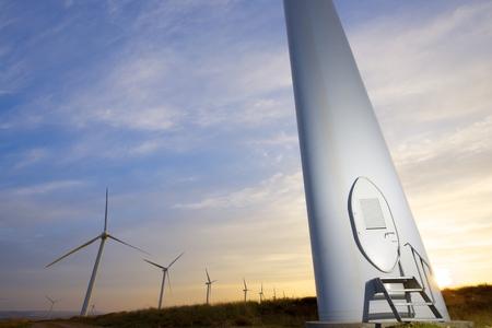 Windmills for electric power production at sunset, Pozuelo de Aragon, Zaragoza, Aragon, Spain photo