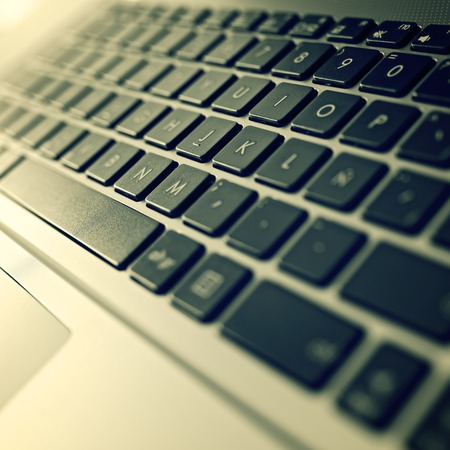 Forefront of a gray laptop keyboard. photo