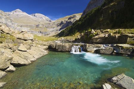 perdido: view of a waterfall and Monte Perdido peak in the valley of ordesa, Pyrenees, Huesca, Aragon, Spain