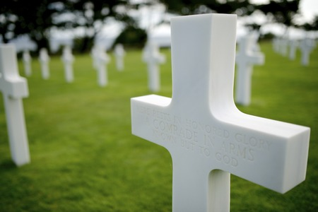 White crosses in American Cemetery, Coleville-sur-Mer, Omaha Beach, Normandy, France. photo