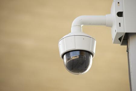 Closeup of a surveillance camera. photo