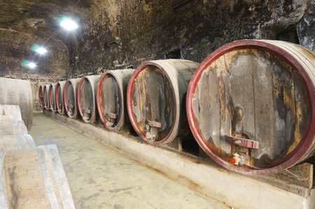 family owned: stacked wine barrels in Breze Castle, Loire Valley, France. Built between the 11th and 19th centuries, it houses an extraordinary subterranean complex, a castle in a castle. It is owned by the family Colbert, and since 2000 is open to the public.