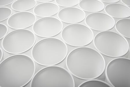 Large group of disposable plastic cups. photo