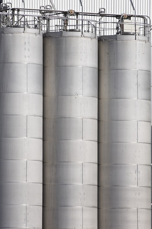 size distribution: Storage tanks detail in a factory. Stock Photo