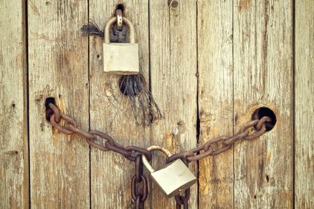 rusty lock in a wood window photo