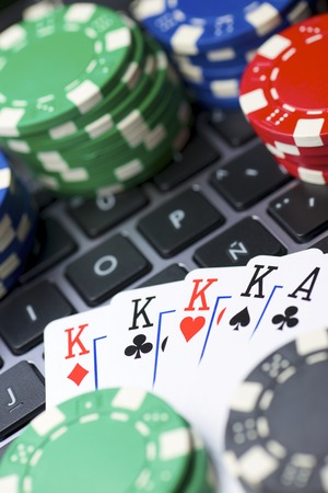 detail internet computer: Casino chips and cards stacking on a laptop