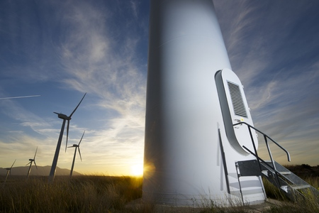 Windmills for electric power production at sunset, Zaragoza province, Aragon, Spain photo