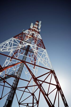 telecommunication equipment: Telecommunications tower with clear blue sky.