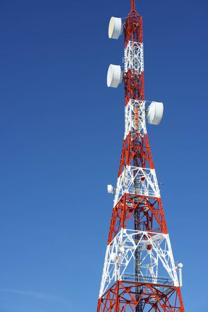 Telecommunications tower with clear blue sky. photo