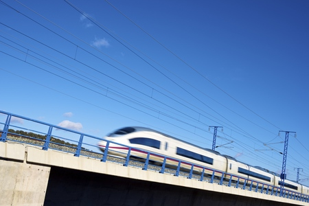 view of a high-speed train crossing a viaduct in Sagides, Soria, Castilla Leon, Spain. AVE Madrid Barcelona.