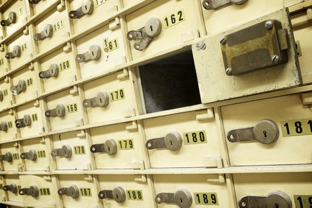 safe: Closeup of a group of cells in an old safe bank.