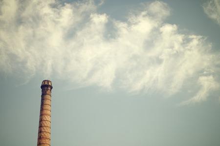 smokestack: Brick smokestack in an old abandoned factory, Spain.