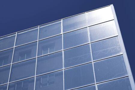 from below: skyscraper from below with blue sky