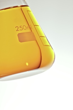 angled view: Angled view of a flask with yellow liquid
