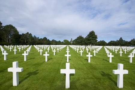 ww2: White crosses in American Cemetery, Coleville-sur-Mer, Omaha Beach, Normandy, France. Stock Photo