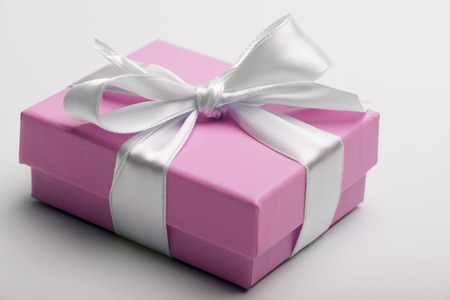Luxury box tied with a white ribbon. Archivio Fotografico