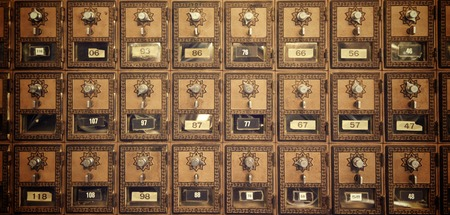 Mailboxes lined up in a post office. photo